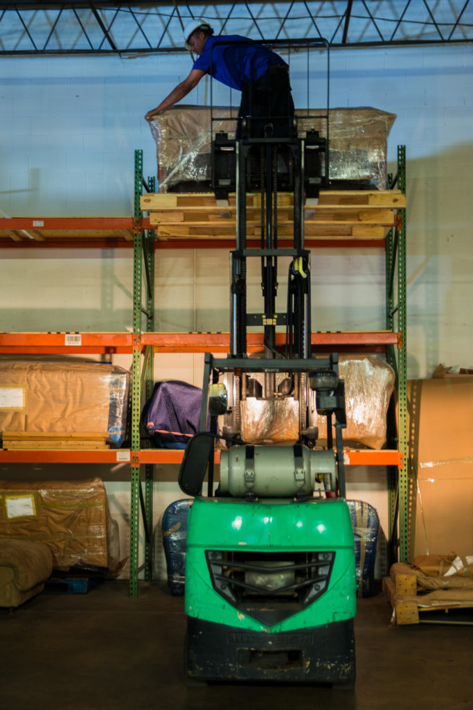 Stacking items in The Green Truck Moving & Storage Company storage facility