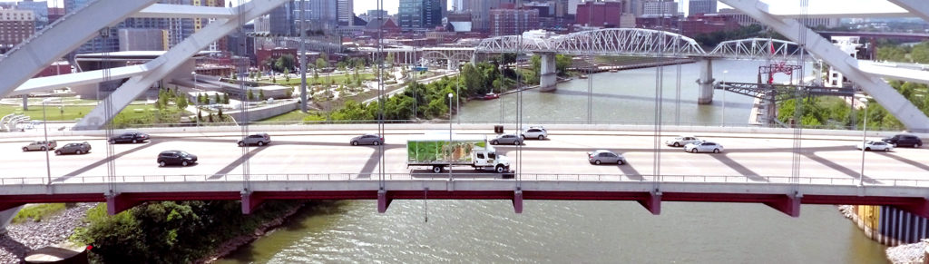 Green Truck on nashville bridge