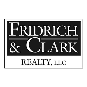 Fridrich & Clark realty logo partners of The Green Truck Moving & Storage Company